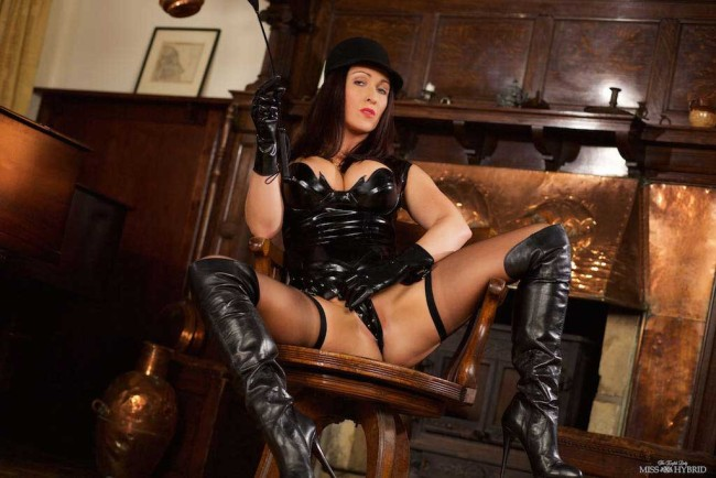 Latex riding mistress Miss Hybrid fucking herself with vintage magic wand and riding crop.