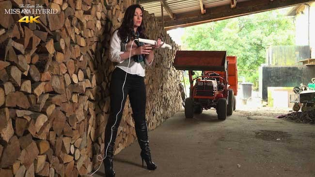 Leather boots and magic wand Miss Hybrid in the wood shed.