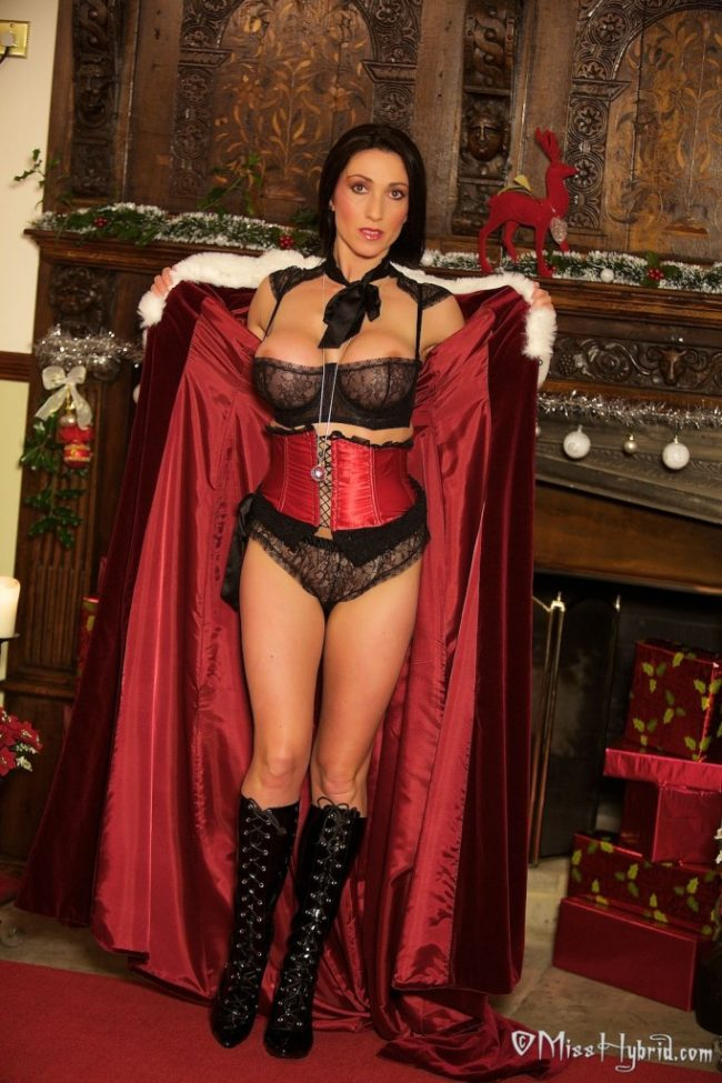 Miss Hybrid snow queen cape slutty black lingerie and shiny boots.