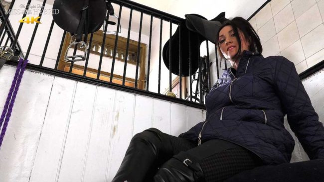 Easy access jodhpurs playing with her Magic Wand Miss Hybrid in the stables.