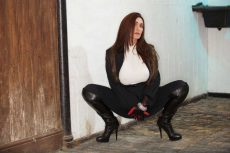 Miss Hybrid leather gloves and boots, easy access jodhpurs and tight white jumper.